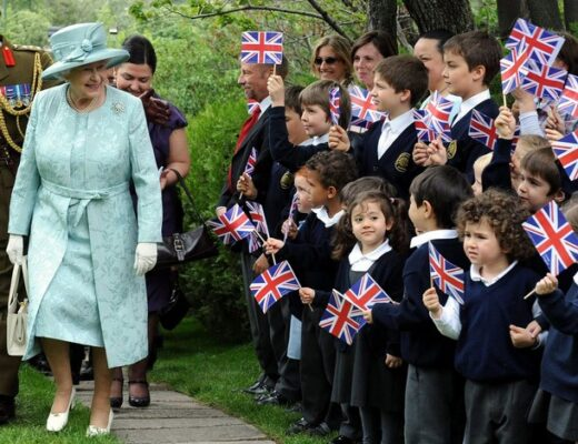 """Britain's Queen Elizabeth II arrives at the British Embassy as children wave flags in Ankara on May 16, 2008. Queen Elizabeth II wrapped up a four-day state visit to Turkey that aimed to stress Britain's support for the mainly Muslim country's EU membership prospects. The queen and her husband Prince Philip left Ankara after attending a reception given to their honour at the British embassy. During the visit, the 82-year-old monarch described Turkey as a """"confident and dynamic democracy"""", praised close ties between Ankara and London and underlined British support for the country's bid to join the European Union. Britain is one of Turkey's main supporters in the EU.  AFP PHOTO / Firat Yurdakul / Pool (Photo credit should read FIRAT YURDAKUL/AFP/Getty Images)"""