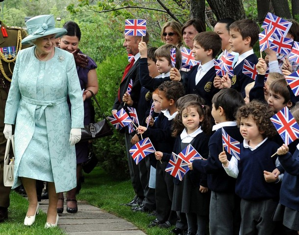 "Britain's Queen Elizabeth II arrives at the British Embassy as children wave flags in Ankara on May 16, 2008. Queen Elizabeth II wrapped up a four-day state visit to Turkey that aimed to stress Britain's support for the mainly Muslim country's EU membership prospects. The queen and her husband Prince Philip left Ankara after attending a reception given to their honour at the British embassy. During the visit, the 82-year-old monarch described Turkey as a ""confident and dynamic democracy"", praised close ties between Ankara and London and underlined British support for the country's bid to join the European Union. Britain is one of Turkey's main supporters in the EU.  AFP PHOTO / Firat Yurdakul / Pool (Photo credit should read FIRAT YURDAKUL/AFP/Getty Images)"